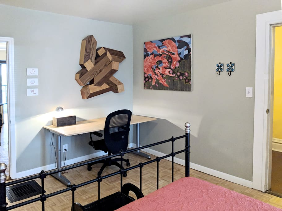 Spacious bedroom with work desk