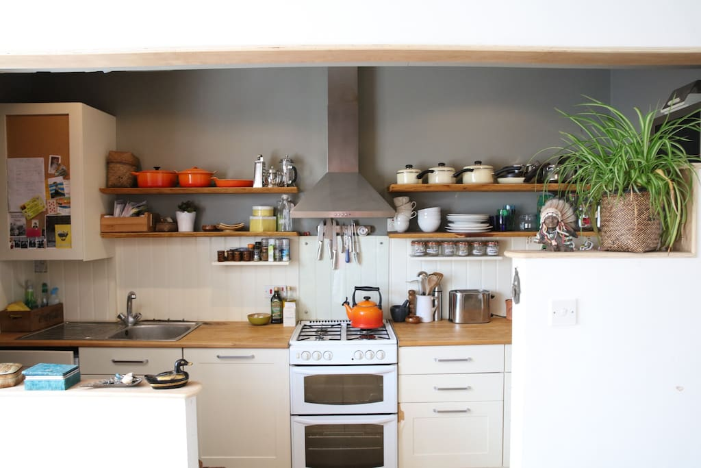 Open plan kitchen with floating oak shelves