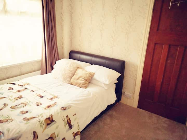 Cosy bedroom situated in the back of the house.