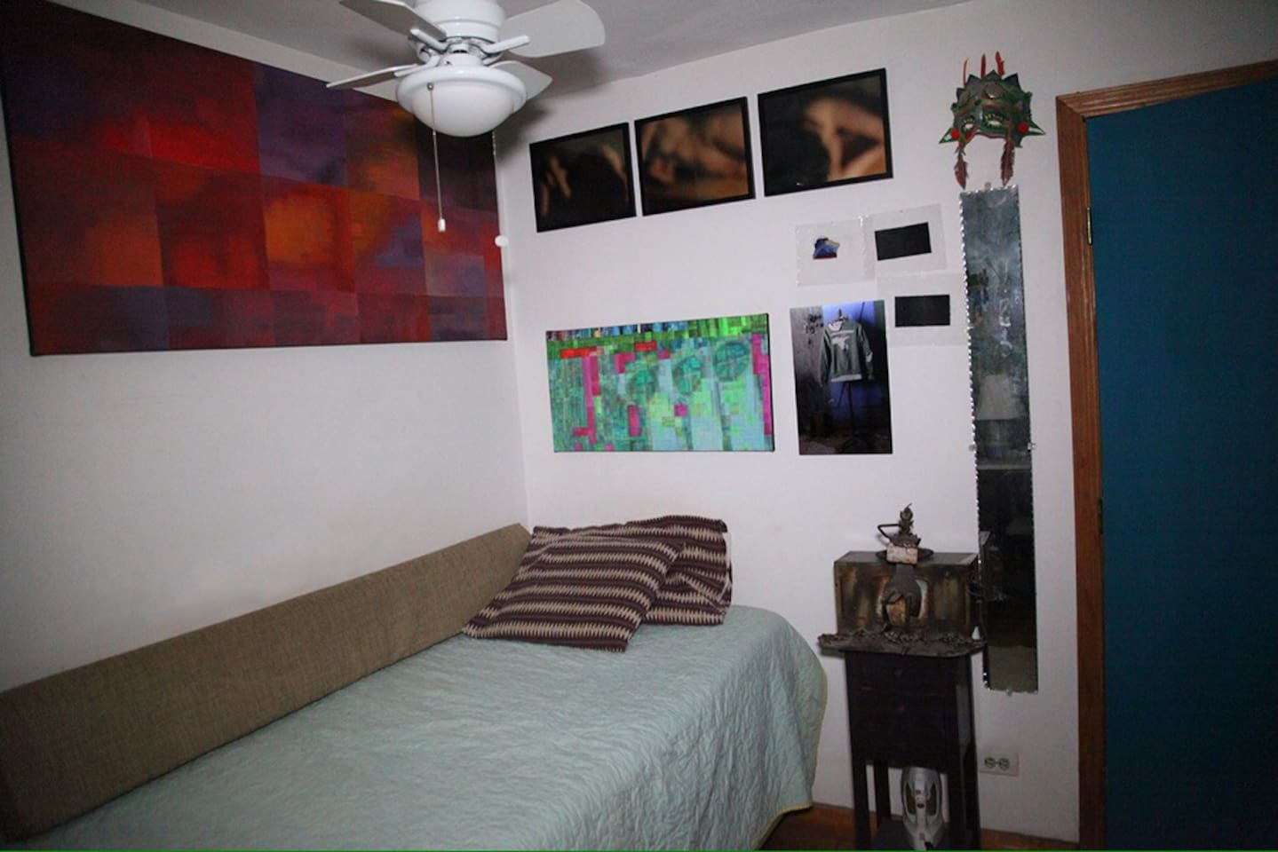 This is the bed and night stand for our guest. The room has its own ceiling fan, air conditioner, heater, and microwave.