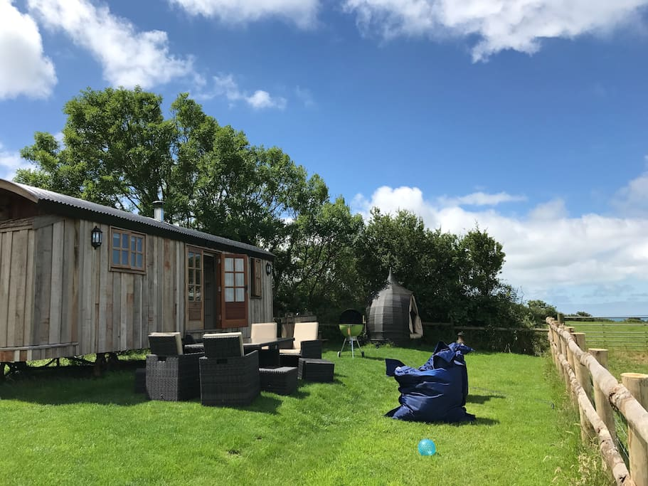Private garden with sea view, surrounded by grazing horses and sheep.  Outdoor furniture including day bed, giant beanbags and a hanging chair. Wood fired hot tub and full size Weber BBQ