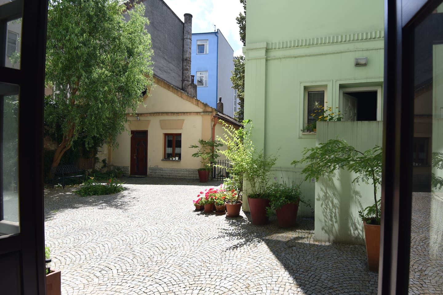 Historic House is situated in the cortyard with a garden.