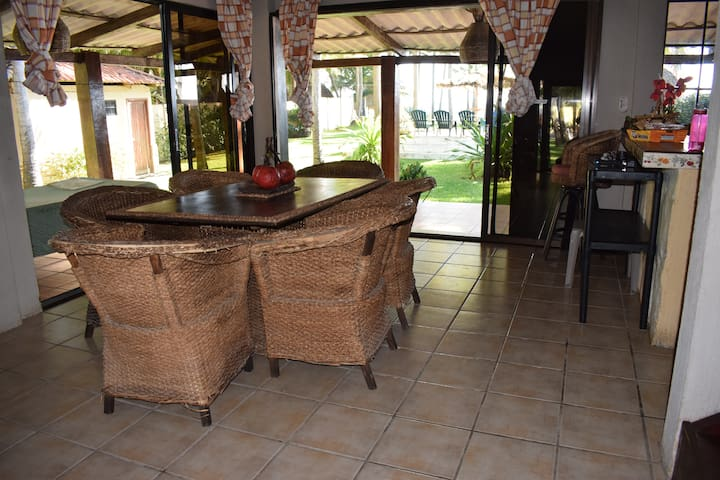Table area with views to the pool and sea.