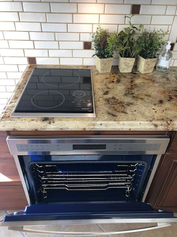 Two burner  induction cooktop and a  Wolf oven.
