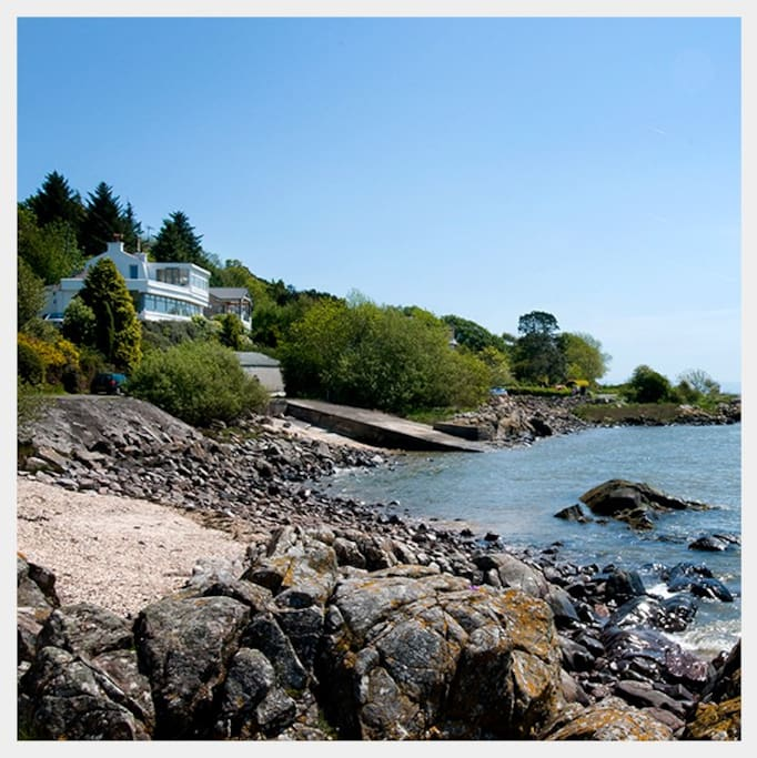 Roughfirth House and shell beach