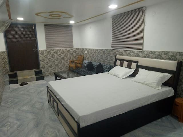 Furnished room with attached bathroom