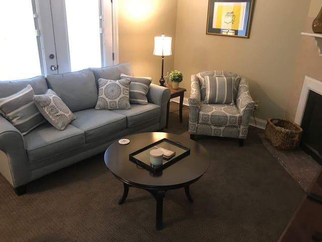 Living room with queen sleeper sofa.
