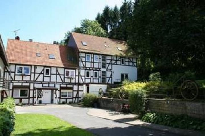 A holiday home in a former water mill just four kilometres from Lake Edersee.