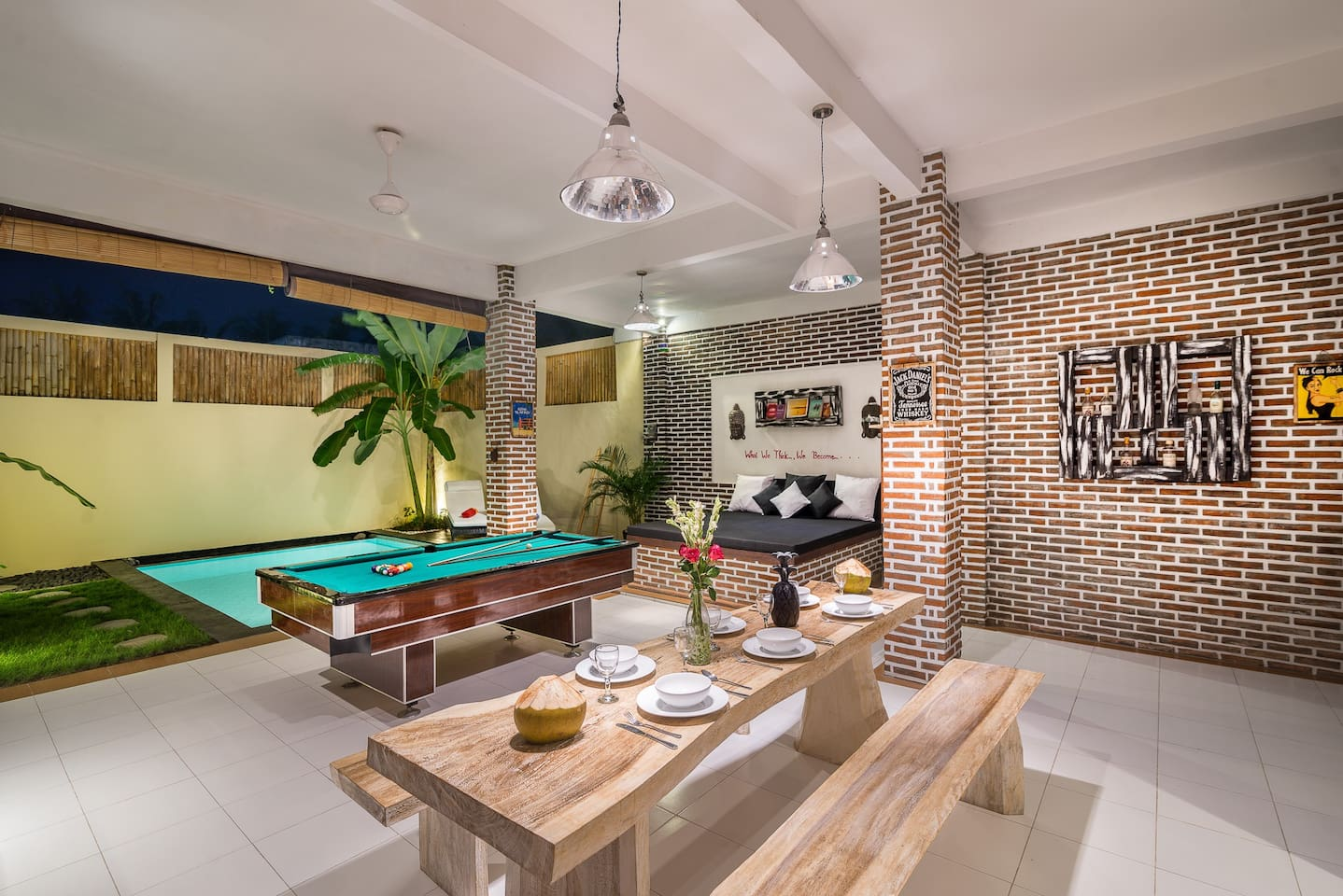 Kitchen view of living room with pool table and garden