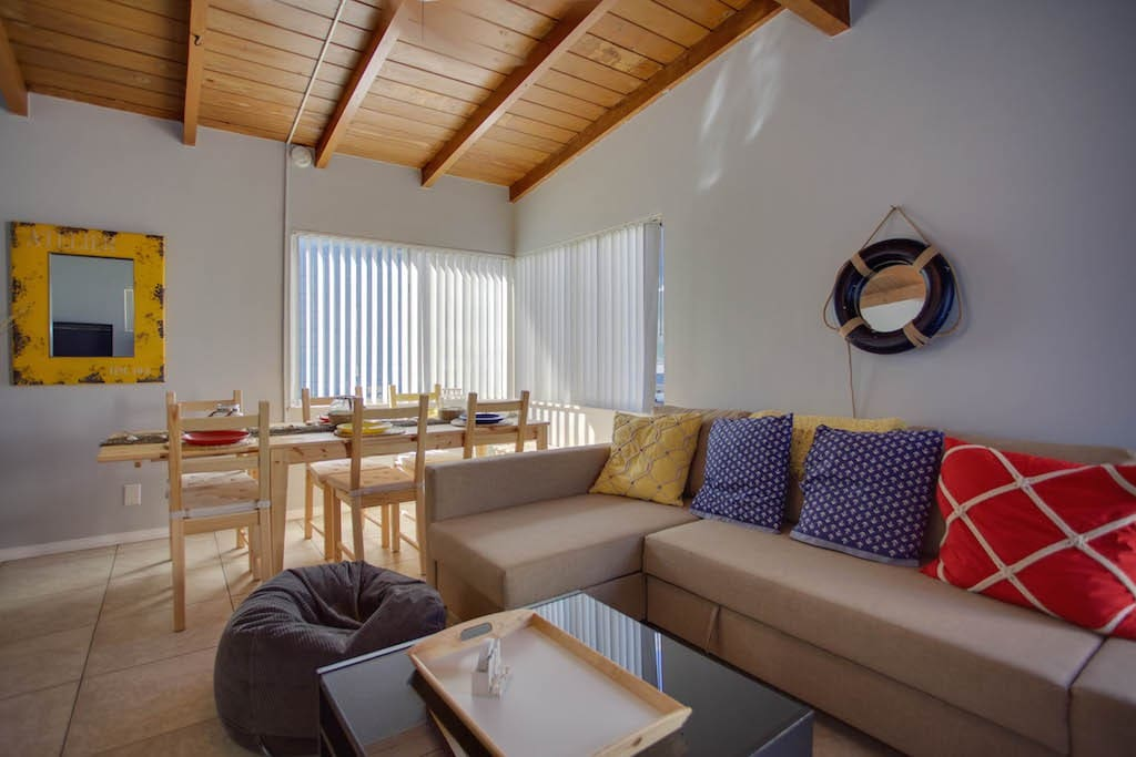 Living and dining areas. Comfy sofa pulls out to full size sleeping accommodations