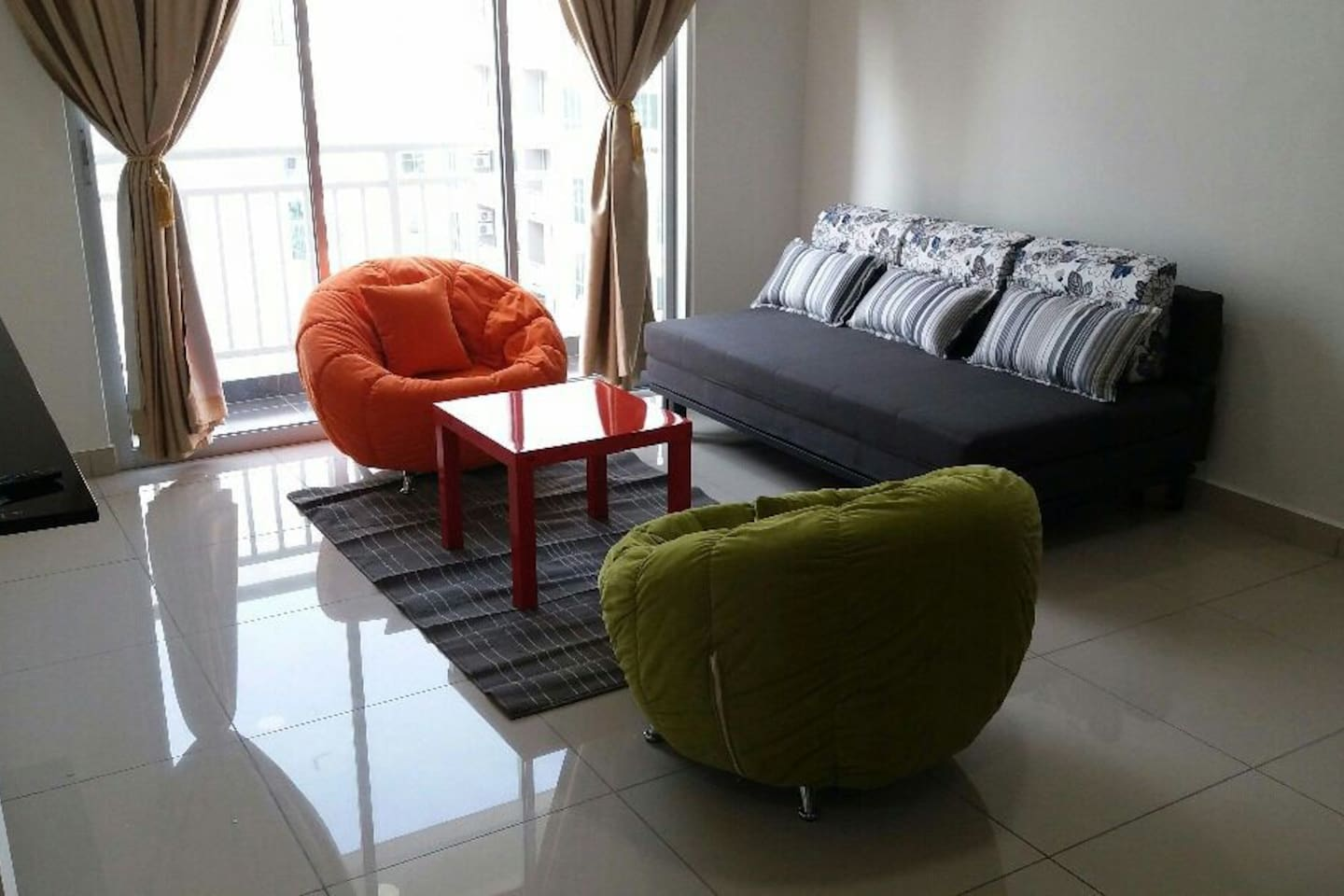 The Aliff Residences living hall with sofa bed