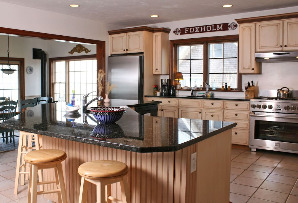 Raised gourmet kitchen with all new stainless steel appliances, large island, 2 sinks, fully stocked pantry, ice maker, lobster pots, grilling utensils, panoramic water views. Overlooks the dining room and Great room. HEAVENLY.