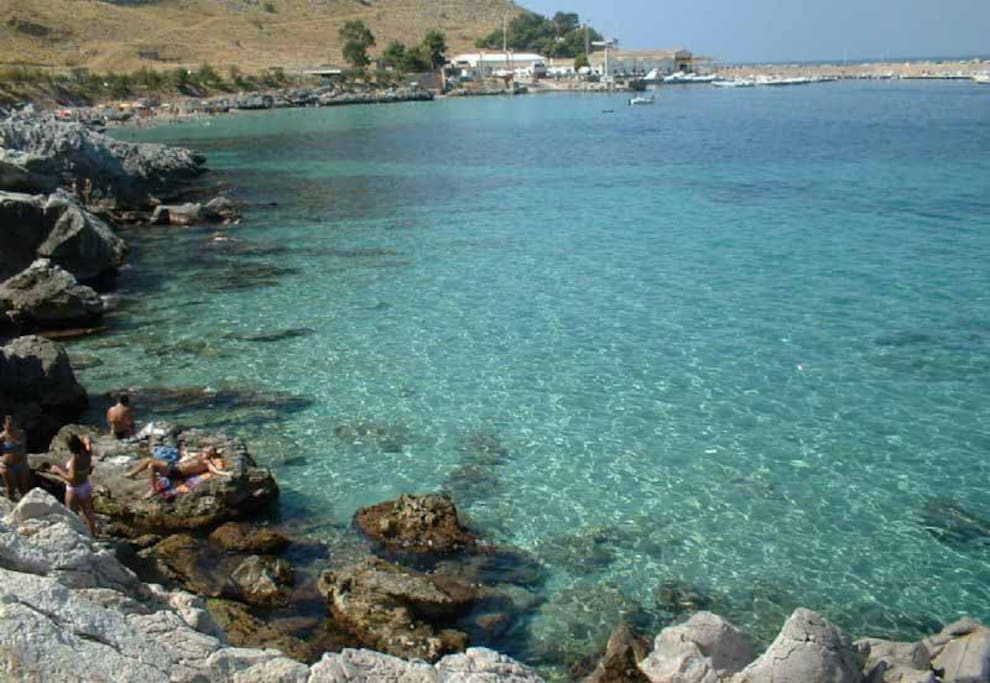 And to the other side of the bay, you have just as wonderful water and rocks just to show off sicilian sea variety