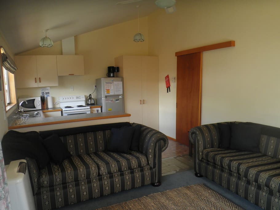 Lounge and kitchen area behind