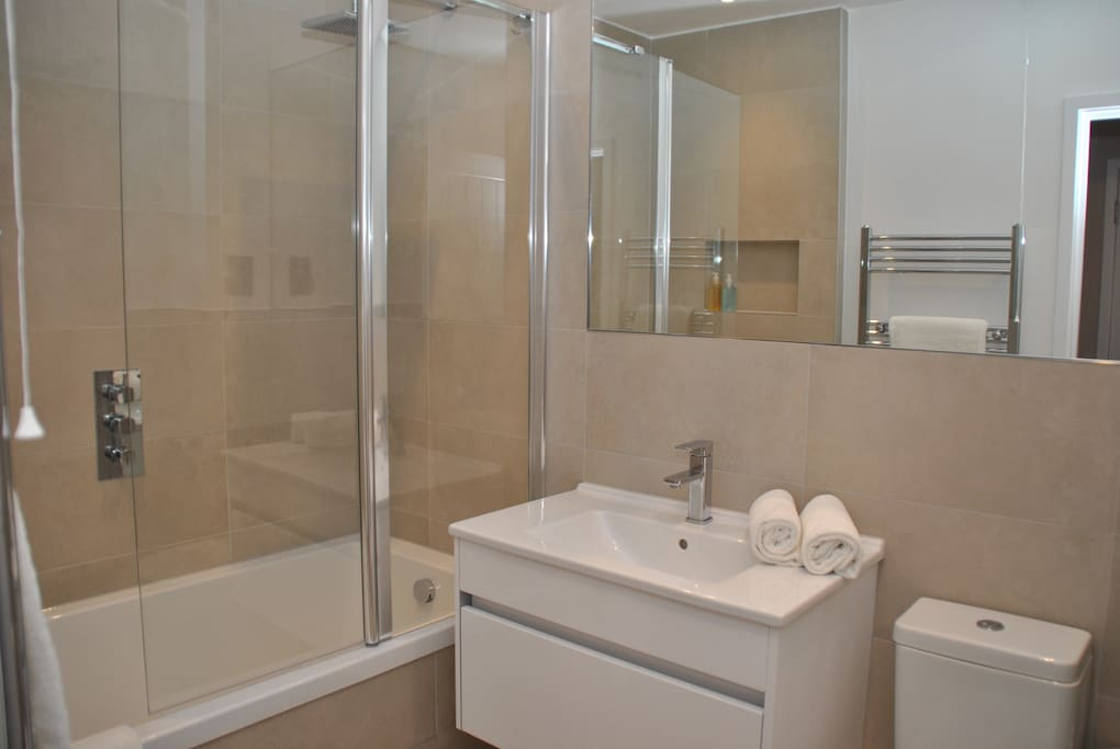brand new bathroom with shower over bath