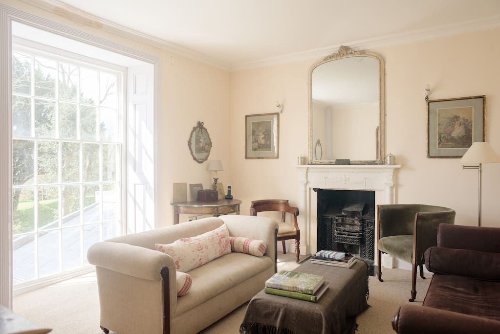 1st Floor:  Sitting room with open fire and sea views