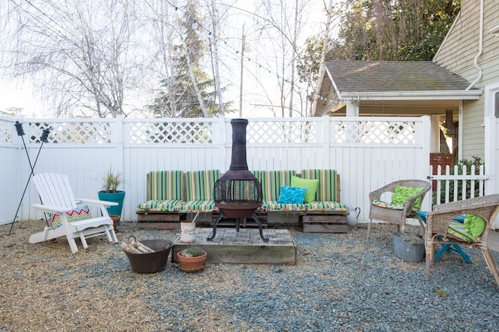 Outdoor fire pit with overhead marketplace lights.