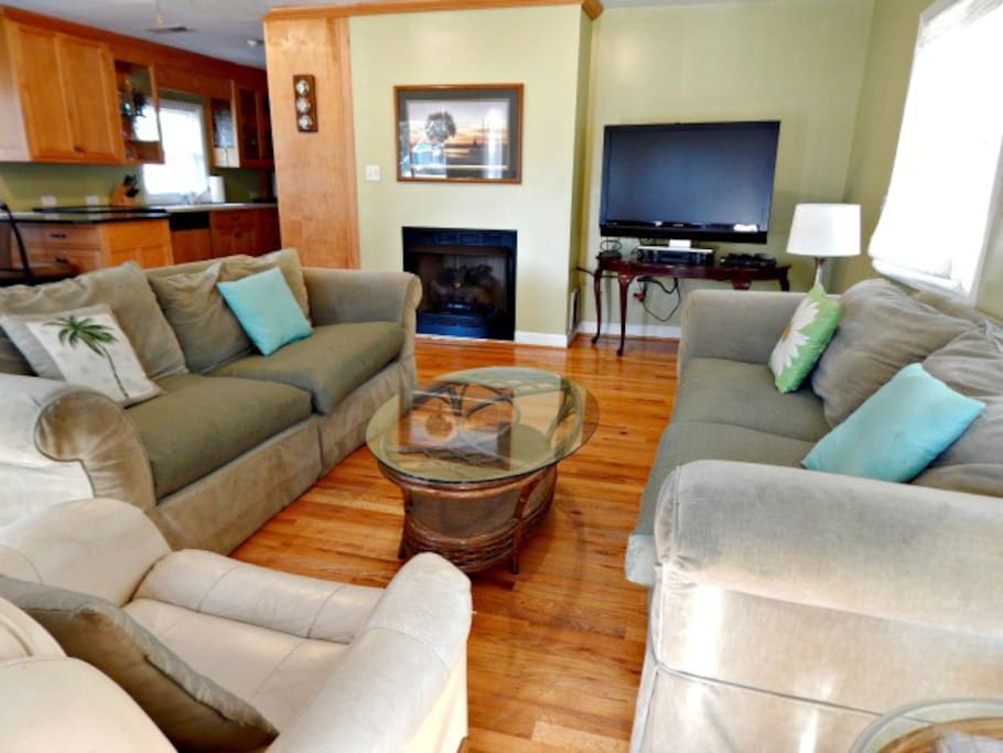 Open floor plan. Living room seating and TV