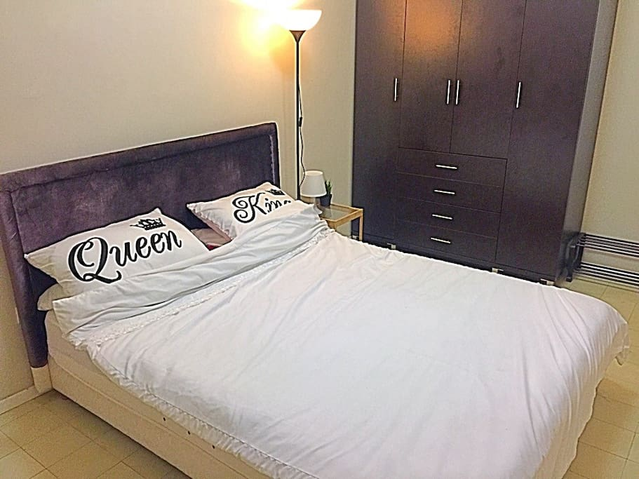 Master bedroom with queen bed, double wardrobe and private balcony