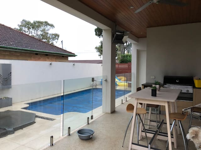 Relax around the Heated Pool and Spa While you enjoy the Famous Aussie BBQ