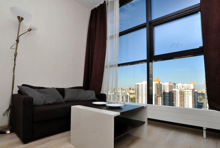 Уютная видовая студия на 21 этаже апарт-отеля