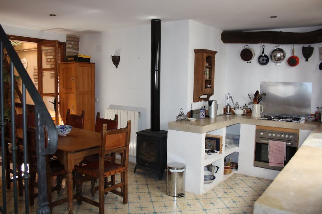 The rustic but well equipped kitchen/diner with wood burner for cooler evenings. Opens on to patio.