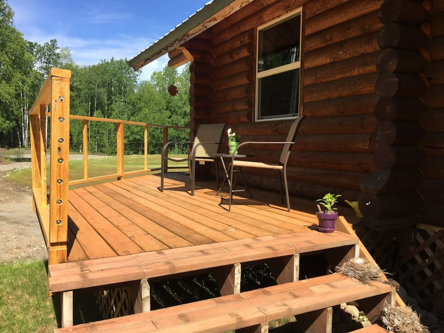Sunny side deck great for relaxing on during our long evenings. Private entrance located on the covered front porch. You will enjoy hearing forest birds, and possibly some wood frogs and loons. Moose often stop by for a visit.