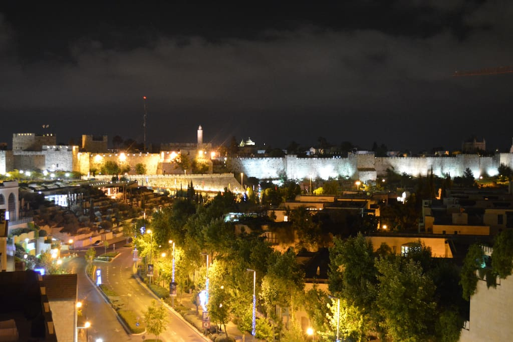 Night view of Old City walls from balcony.