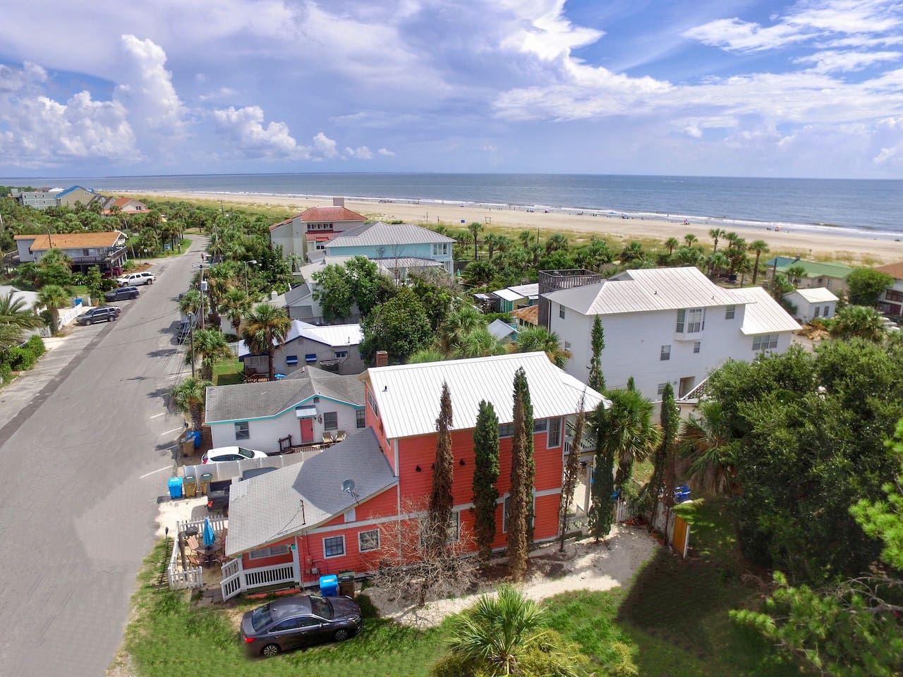Aerial view of the Coral House showing proximity to the beach (1/2 block). The Peach Penthouse is the entire upper floor.