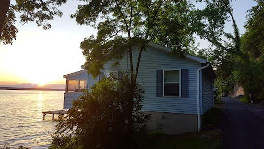Cozy Cottage Overhanging Cayuga Lake