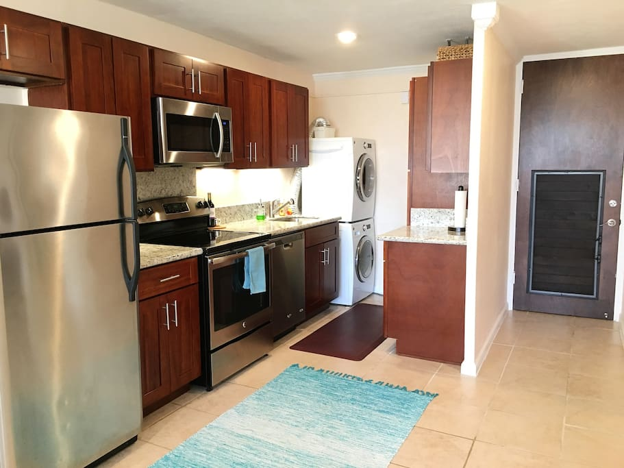 Modern Kitchen and washer/dryer in unit for your convenience.
