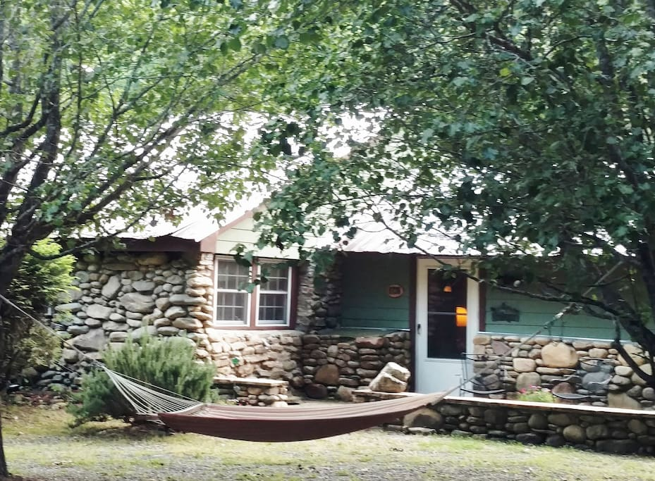 Enjoy our stone cabin from the hammock.