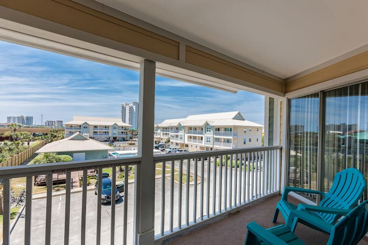 Enjoy the Gulf breeze on the covered balcony, where there's seating for 4.