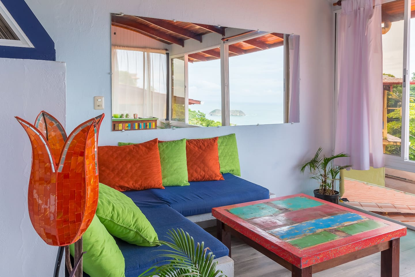 You will want to spend lots of time in the enclosed Porch Lounge, shown here with a reflected island view.  Pura Vida Living!