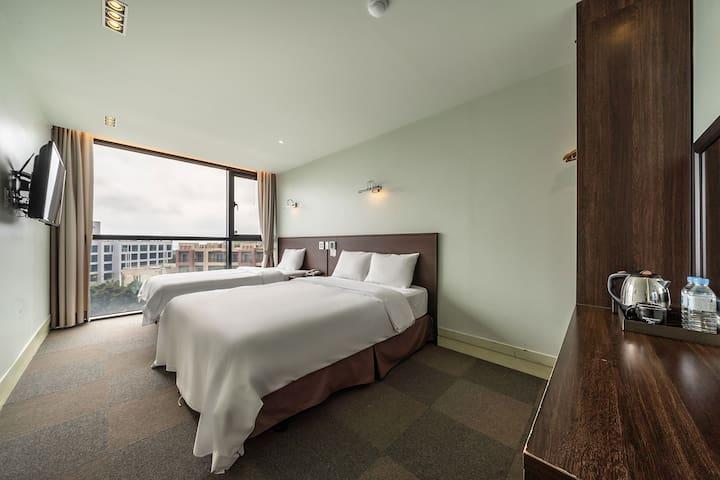 썬라이즈호텔 중문점 디럭스3인실