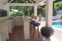 Pool house has a bar, sink, barbecue, refrigerator, 2 coolers and several chairs/tables for you and your guests to use