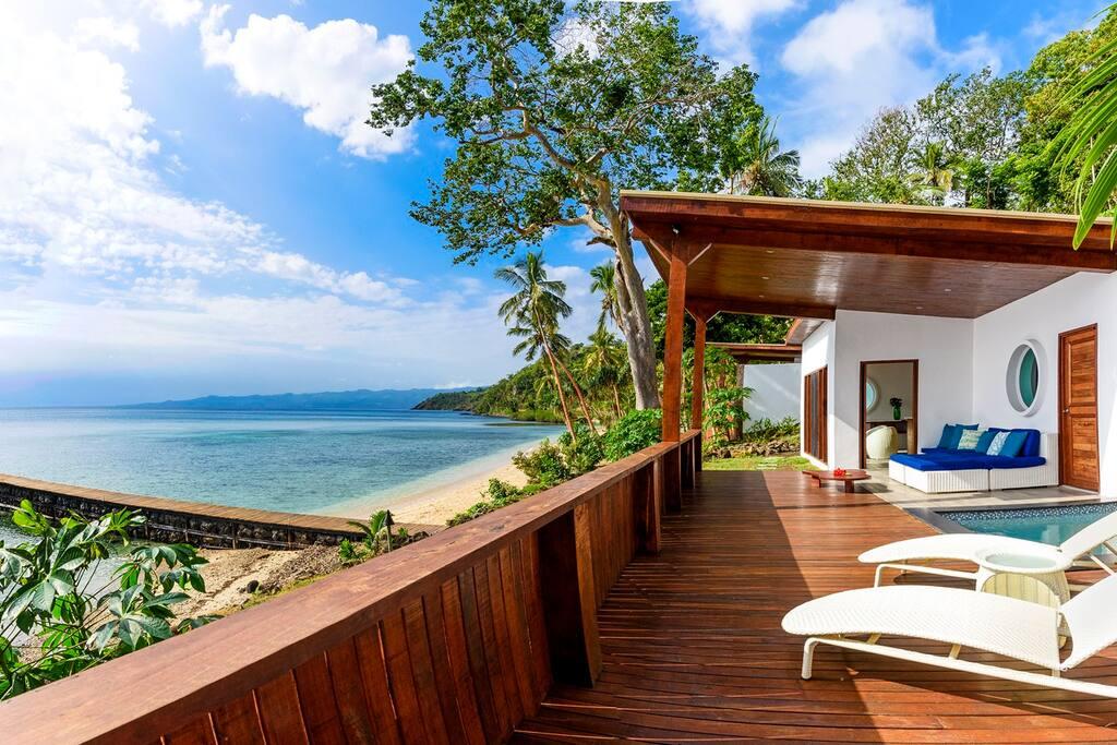 Oceanfront Retreat deck looking to beach