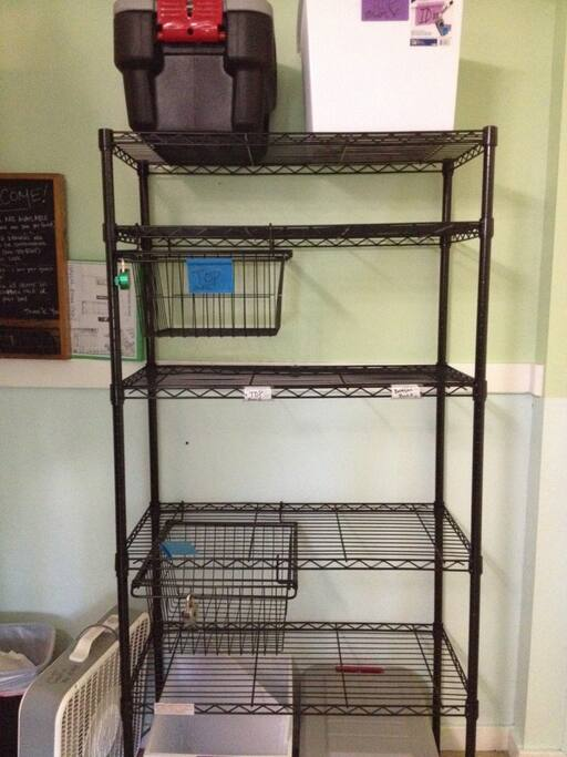 """Guests in bottom bunks have access to 2 separate shelving units with shelves labeled """"BOTTOM"""" for this guests to use."""