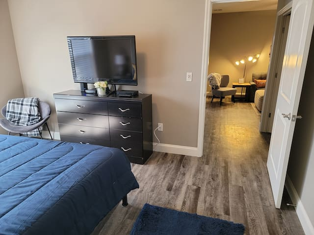 """Master bedroom, 34"""" TV with charter cable, high speed internet, and WiFi."""