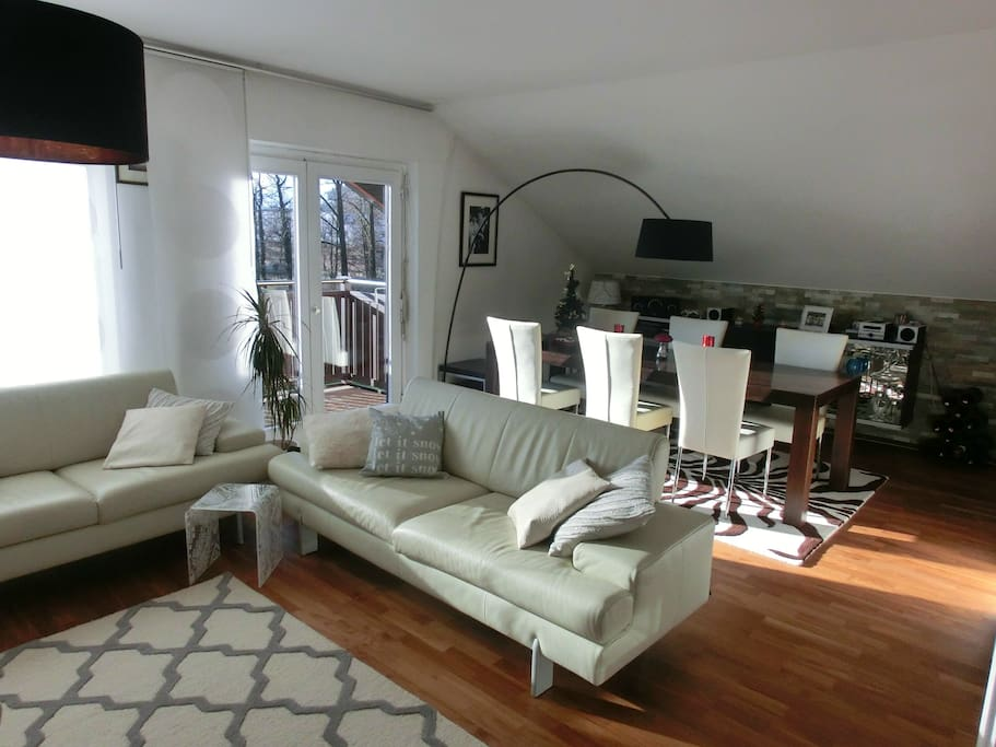 The living room with 2 cosy sofas to relax after a long sightseeing trip