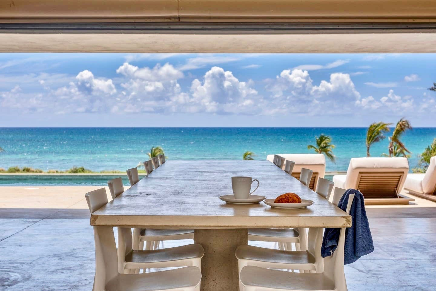 Built in concrete dining room table with seating for 12 and water views to die for.