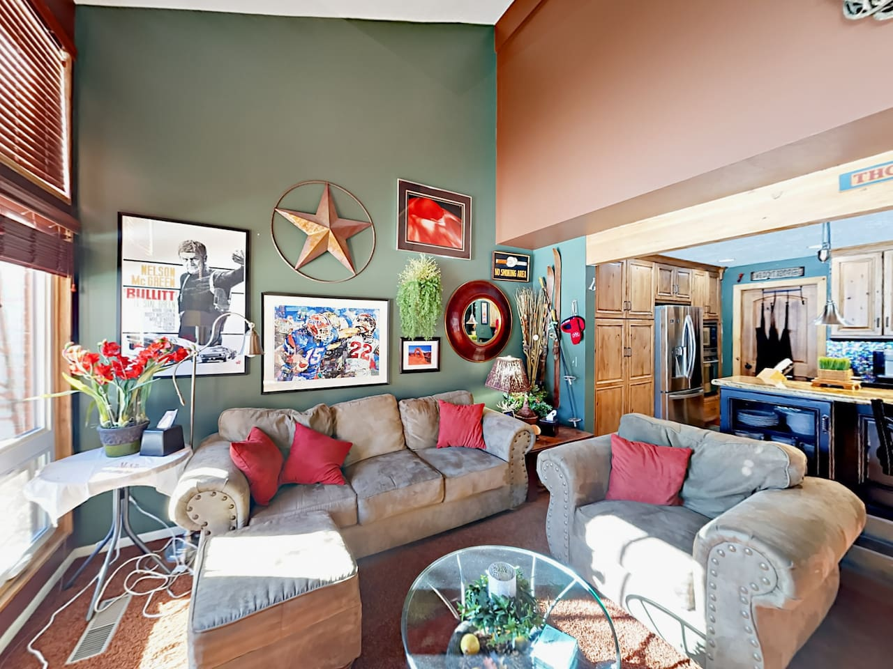 Welcome to Park City! A 2nd living area beside the kitchen offers comfy seating between a couch and armchair.