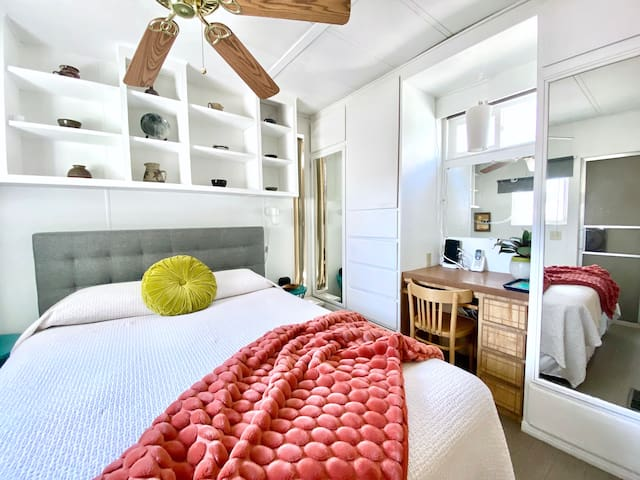 Queen bed & dedicated work station with a phone and high speed 100mbps internet.