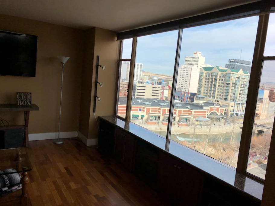 Floor to ceiling river and city views