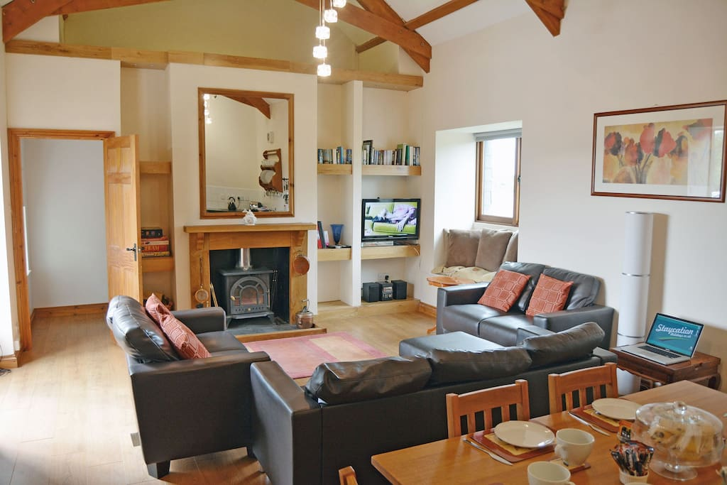 Ground floor spacious open plan sitting area with a wood burning stove