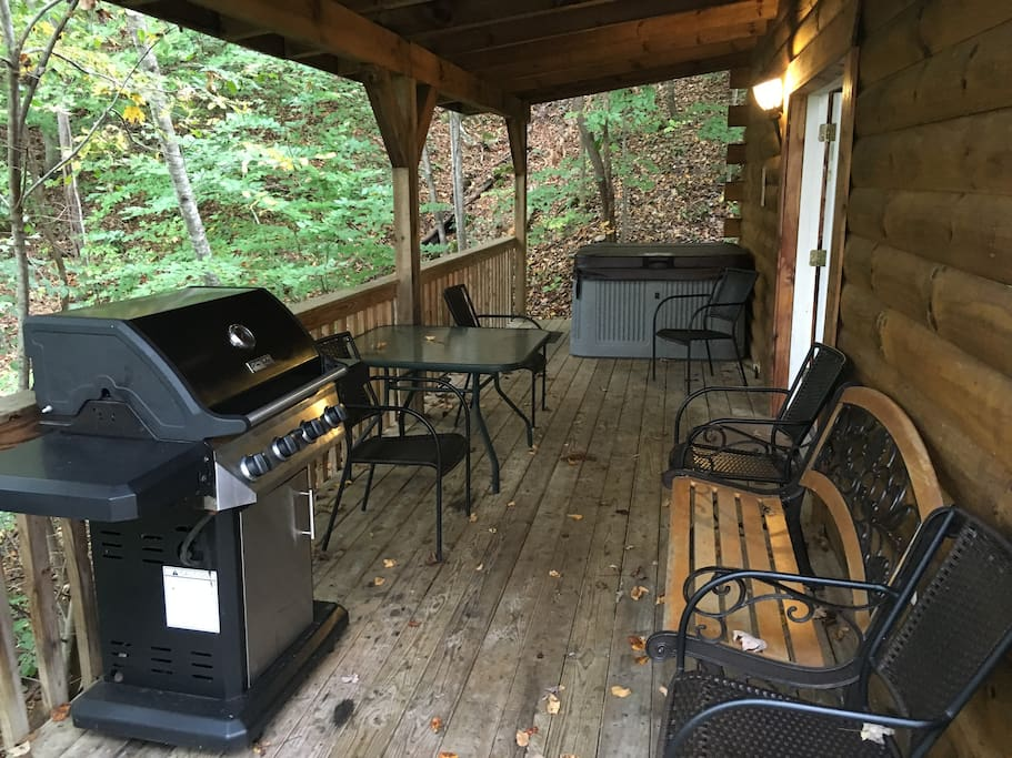 View of left covered deck showing hot tub and propane grill