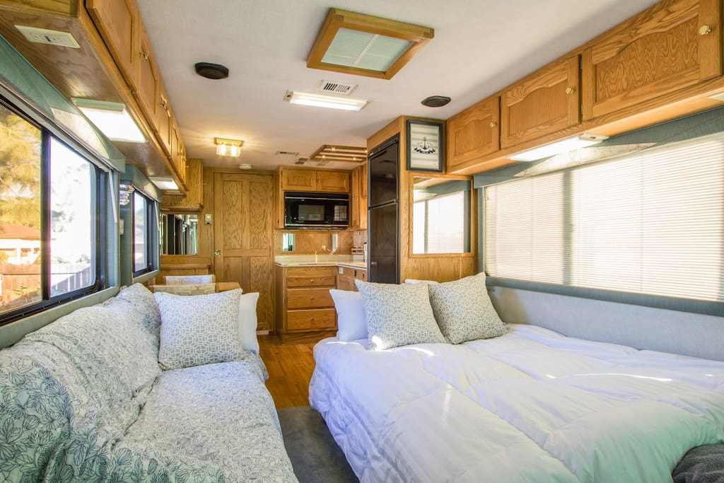 Living room converts to a second private bedroom at night with double and single bed.  We also can provide an additional twin air mattress for larger groups that sits on the front carpeted area.