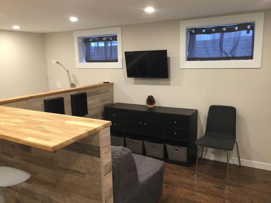 Open concept studio, small but with everything at your fingertips. TV with adjustable arm allows you to watch from counter, couch or bed.