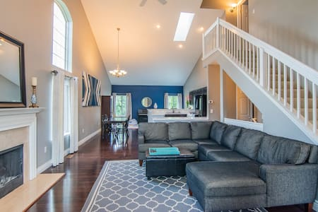 Family home with hot tub. Short drive downtown.