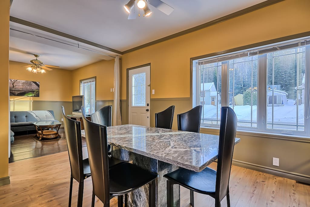 Large sunny dining area open to living room...